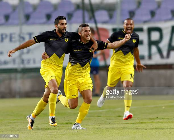 Hen Ezra of Beitar Jerusalem celebrates his first goal with Idan Vered and Claudemir during the UEFA Europa League First Qualifying Round 2nd leg...