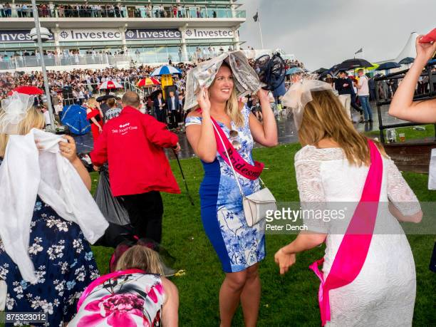 A hen party cope with a downpour on race day at Epsom Ladies' Day is traditionally held on the first Friday of June a multitude of ladies and gents...