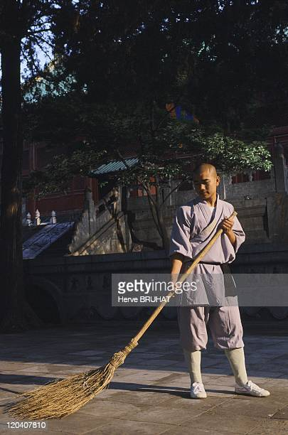 Henan in Shaolin, China - In China when one arrives very early in the morning in a temple, one inevitably sees the ritual of sweeping the terraces....