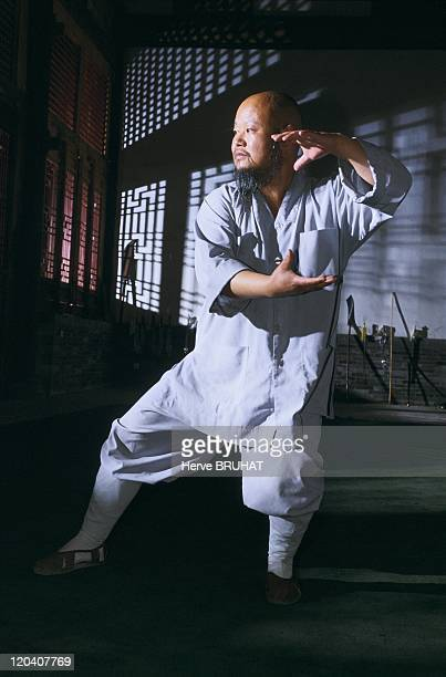 """Henan in Shaolin, China - Master Shi Yan Zhunag repeats a taolu in the temple training room. """"At Shaolin, we practice more than a hundred sequence of..."""