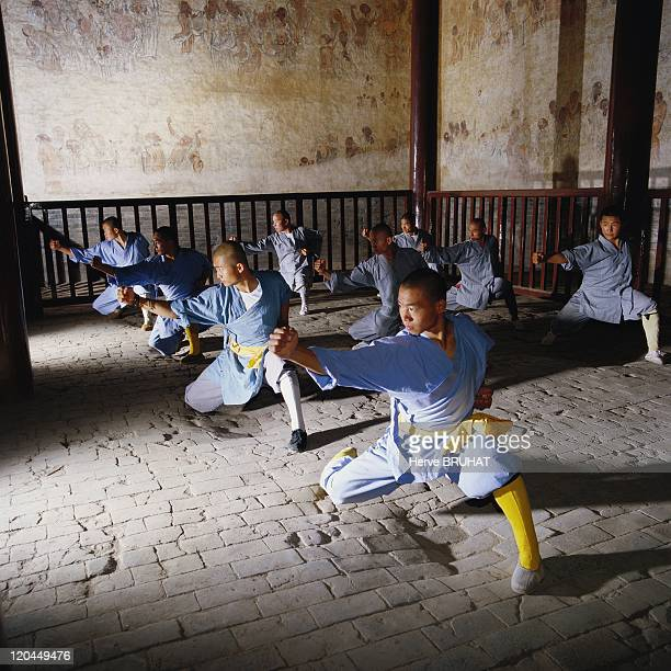 Henan in Shaolin, China - Training in the Hall of a Thousand Buddha's. Built in 1588, the Hall of a Thousand Buddha's is the most ancient part of the...