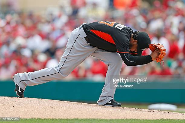 Henderson Alvarez of the Miami Marlins goes through a ritual before throwing his first pitch against the St Louis Cardinals during a spring training...