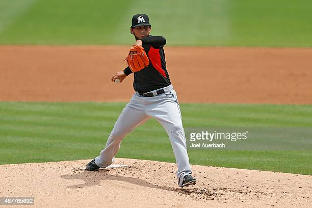 Henderson Alvarez of the Miami Marlins throws the ball against the St Louis Cardinals during a spring training game at Roger Dean Stadium on March 26...
