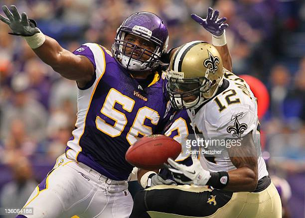 J Henderson of the Minnesota Vikings attempts to disrupt the pass to Marques Colston of the New Orleans Saints at the Hubert H Humphrey Metrodome on...
