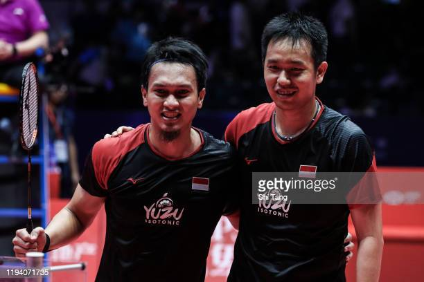 Hendra Setiawan and Mohammad Ahsan of Indonesia celebrate the victory in the Men's Double final match against Hiroyuki Endo and Yuta Watanabe of...
