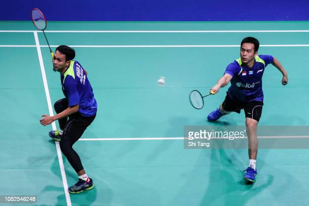 Hendra Setiawan and Mohammad Ahsan of Indonesia compete in the Men's Doubles quarter finals match against Han Chengkai and Zhou Haodong of China on...