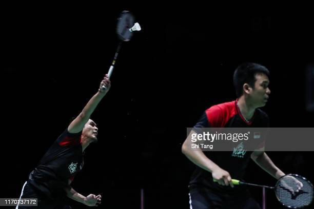 Hendra Setiawan and Mohammad Ahsan of Indonesia compete in the Men's Double final match against Takuro Hoki and Yugo Kobayashi of Japan during day...