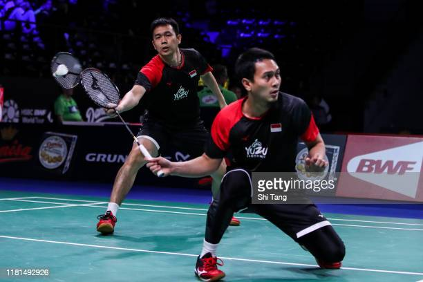 Hendra Setiawan and Mohammad Ahsan of Indonesia compete in the Men's Doubles first round match against Goh V Shem and Tan Wee Kiong of Malaysia on...