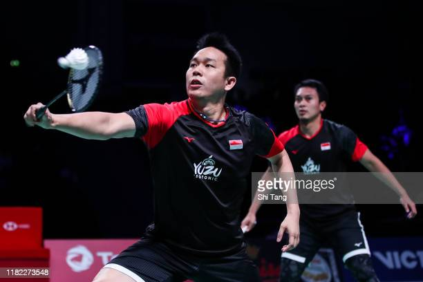 Hendra Setiawan and Mohammad Ahsan of Indonesia compete in the Men's Double final match against Marcus Fernaldi Gideon and Kevin Sanjaya Sukamuljo of...