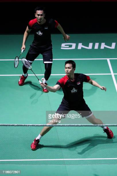 Hendra Setiawan and Mohammad Ahsan of Indonesia compete in the Men's Doubles second round match against Zhang Nan and Ou Xuanyi of China on day three...