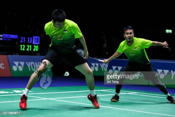 Hendra Setiawan and Mohammad Ahsan of Indonesia compete in the Men's Doubles first round match against Akira Koga and Taichi Saito of Japan on day...