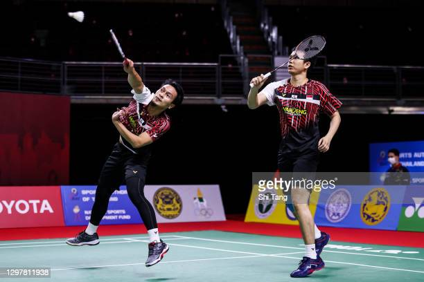 Hendra Setiawan and Mohammad Ahsan of Indonesia compete in the Men's Doubles quarter finals match against Ben Lane and Sean Vendy of England on day...