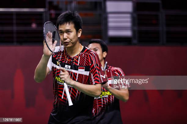 Hendra Setiawan and Mohammad Ahsan of Indonesia greet Ben Lane and Sean Vendy of England after their Men's Doubles quarter finals match on day four...