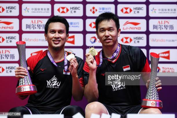 Hendra Setiawan and Mohammad Ahsan of Indonesia pose with their trophies after the Men's Double final match against Hiroyuki Endo and Yuta Watanabe...