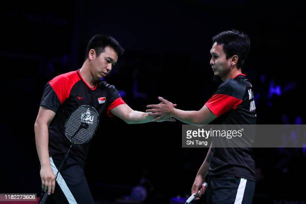 Hendra Setiawan and Mohammad Ahsan of Indonesia react in the Men's Double final match against Marcus Fernaldi Gideon and Kevin Sanjaya Sukamuljo of...