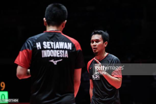 Hendra Setiawan and Mohammad Ahsan of Indonesia react in the Men's Double final match against Hiroyuki Endo and Yuta Watanabe of Japan during day...