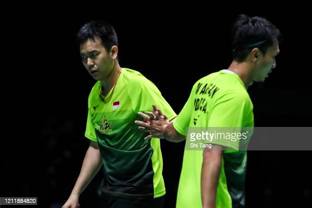 Hendra Setiawan and Mohammad Ahsan of Indonesia react in the Men's Doubles first round match against Akira Koga and Taichi Saito of Japan on day one...