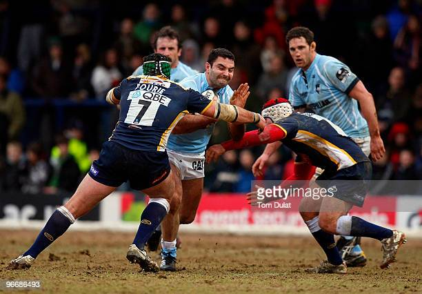Hendre Fourie and Andy Titterrell of Leeds Carnegie tackle running with the ball Jeremy Staunton of Leicester Tigers during the Guinness Premiership...