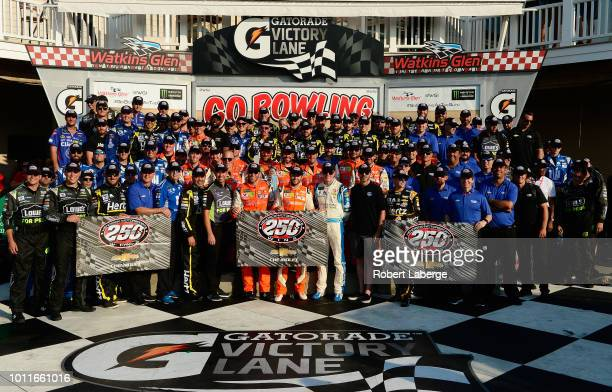 Hendrick Motor Sports team members pose for a photo representing their 250th win after Chase Elliott, driver of the SunEnergy1 Chevrolet, wins the...