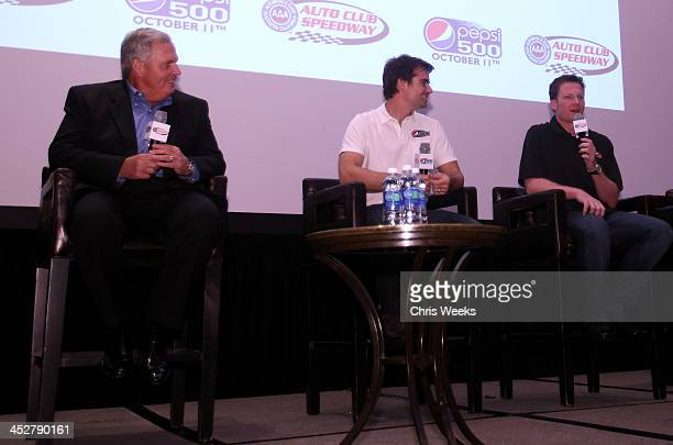Hendrick Motorsports president Rick Hendrick NASCAR drivers Jeff Gordon and Dale Earnhardt Jr speak during The Pepsi 500 Auto Club Speedway...