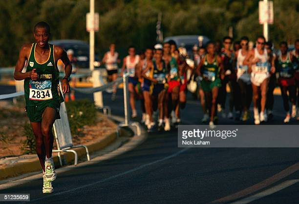 Hendrick Ramaala of South Africa leads the pack of runners early on in the men's marathon on August 29, 2004 during the Athens 2004 Summer Olympic...