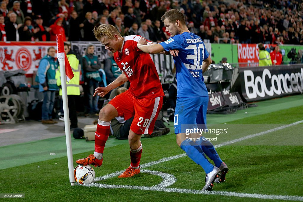 Hendrick Zuck of Braunschweig (R) challenges Joel Pohjanpalo of Duesseldorf (L) during the Second Bundesliga match between Fortuna Duesseldorf and Eintracht Braunschweig at Esprit-Arena on December 7, 2015 in Duesseldorf, Germany.