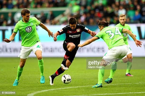 Hendrik Hansen and Ricardo Rodriguez of Wolfsburg and Chicharito of Leverkusen battle for the ball during the Bundesliga match between VfL Wolfsburg...