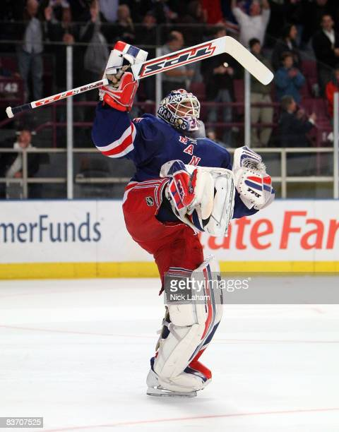 Hendrik Lundqvist of the New York Rangers celebrates making the game winning save in the shootout against the Boston Bruins on November 15, 2008 at...