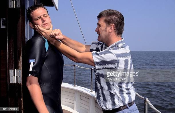 Hendrik Martz William Mang ARDSurferSerie Gegen den Wind Folge 17 Wer nicht hören will StPeter Ording Deutschland Motorboot NeoprenAnzug Streit...