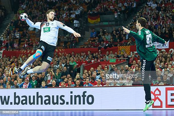 Hendrik Pekeler from Germany throws the ball against goalkeeper Victor Kireev from Russia during the Men's EHF Handball European Championship 2016...