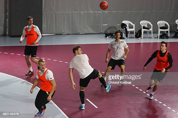 Hendrik Pekeler Matthias Musche Michael Kraus Uwe Gensheimer and Patrick Groetzki kick football during the training session of Germany at Lusail...
