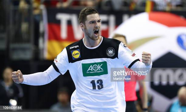 Hendrik Pekeler of Germany celebrates scoring a goal during the 26th IHF Men's World Championship group A match between Germany and France at...