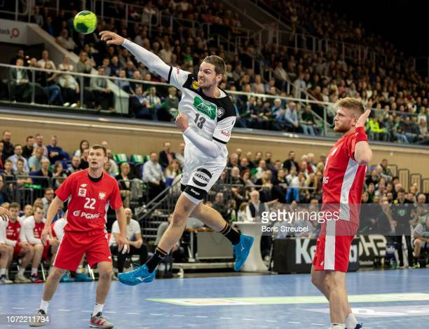 Hendrik Pekeler of Germany in action with Maciej Gebala of Poland during the international friendly handball match between Germany and Poland at...