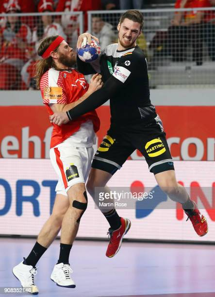 Hendrik Pekeler of Germany is challenged by Mikkel Hansen of Denmark during the Men's Handball European Championship main round group 2 match between...