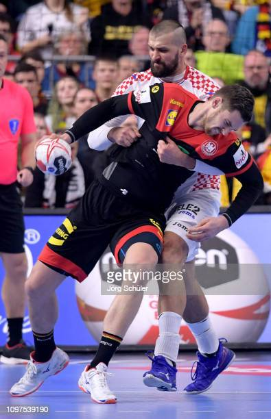 Hendrik Pekeler of Germany is challenged by Zeljko Musa of Croatia during the 26th IHF Men's World Championship group 1 match between Croatia and...