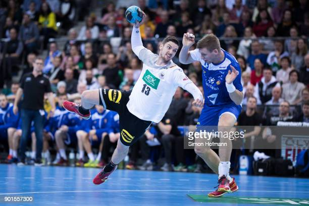 Hendrik Pekeler of Germany tries to score against Olafur Gudmundsson of Iceland during the International Handball Friendly match between Germany and...