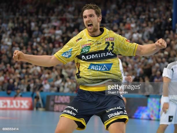 Hendrik Pekeler of Rhein Neckar celebrates scoring the winning goal during the first leg round of 16 EHF Champions League match between THW Kiel and...