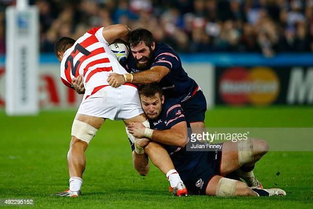 Hendrik Tui of Japan is wrapped up by Phil Thiel of the United States during the 2015 Rugby World Cup Pool B match between USA and Japan at Kingsholm...