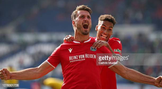 Hendrik Weydandt and Linton Maina of Hannover 96 celebrate after scoring during the Second Bundesliga match between Hannover 96 and Eintracht...