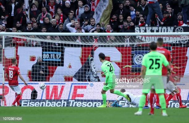 Hendrik Weydandt of Hannover 96 scores his team's first goal during the Bundesliga match between 1 FSV Mainz 05 and Hannover 96 at Opel Arena on...