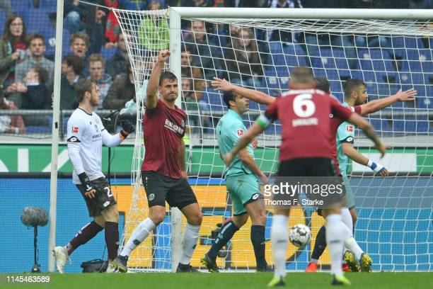Hendrik Weydandt of Hannover celebrates scoring his teams first goal during the Bundesliga match between Hannover 96 and 1 FSV Mainz 05 at HDIArena...