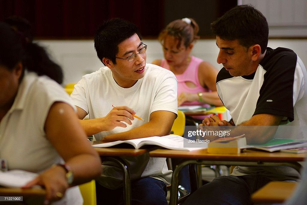Heng Lin (L), originally from China and Jose Bolano, orginally from Cuba, learn how to speak English in class at the English Center June 16, 2006 in Miami, Florida. The school holds adult education classes that include English language classes for people who have immigrated to the United States. U.S. President George W. Bush recently said, ?Part of the greatness of America is that we've been able to help assimilate people into our society... And part of that assimilation process is English. I believe this: If you learn English, and you're a hard worker, and you have a dream, you have the capacity from going from picking crops to owning the store, or from sweeping office floors to being an office manager.?