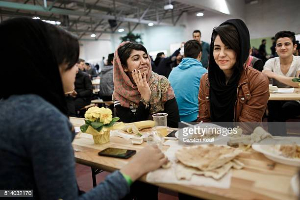 Hengame Hessni a refugee from Afghanistan chats with her friends during the 139th anniversary celebration of the Berlin Stadtmission at a shelter for...