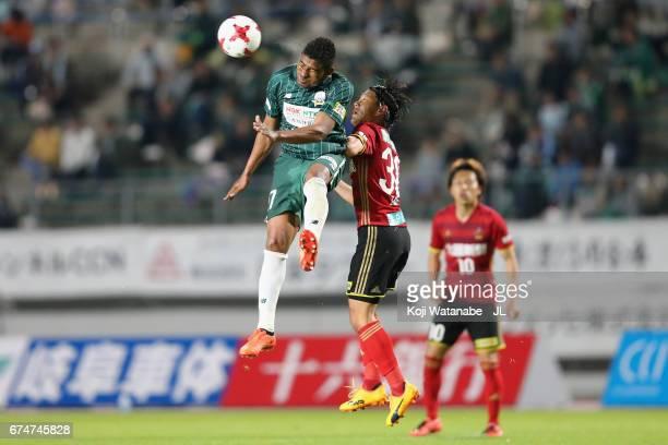Henik of FC Gifu and Masato Yamazaki of Zweigen Kanagawa compete for the ball during the J.League J2 match between FC Gifu and Zweigen Kanazawa at...