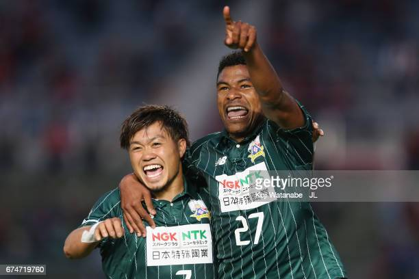 Henik of FC Gifu celebrates scoring the opening goal with his team mate Paulo Junichi Tanaka during the JLeague J2 match between FC Gifu and Zweigen...