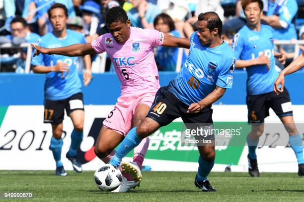 Henik of Tochigi SC and Leandro Domingues of Yokohama FC compete for the ball during the JLeague J2 match between Yokohama FC and Tochigi SC at...