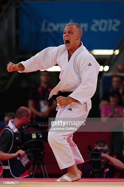 Henk Grol of Netherlands celebrates defeating HeeTae Hwang of Korea in the Men's 100 kg Judo on Day 6 of the London 2012 Olympic Games at ExCeL on...