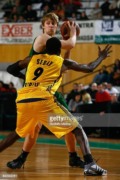 Henk Norel #17 of DKV Joventut competes with Ansu Sesay #9 of Alba Berlin during the Euroleague Basketball Game 9 match between DKV Joventut and Alba...