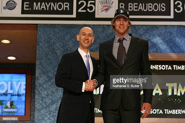 Henk Norel shakes hands with NBA Deputy Commissioner Adam Silver after being selected forty seventh by the Minnesota Timberwolves during the 2009 NBA...