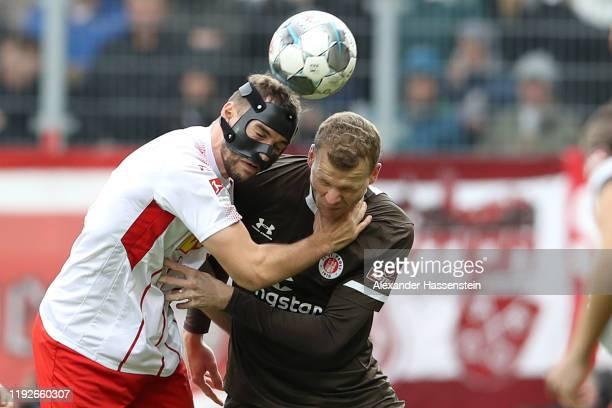 Henk Veerman of St. Pauli battles for the ball with Benedikt Gimber of Regensburg during the Second Bundesliga match between SSV Jahn Regensburg and...